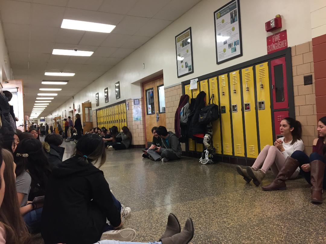 Students sitting in hallways at Bergen County Academies during the National School Walkout