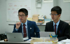 2 members of BCA Model United Nations during their delegation's presentation.