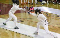 Bergen Technical High Schools Isabella Impalli (left) vs. Columbia High Schools Isabelle Wendt during the girls fencing final at Morris Hills High School in Rockaway