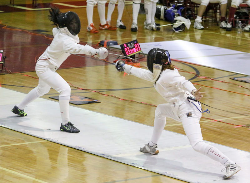Bergen Technical High School's Isabella Impalli (left) vs. Columbia High School's Isabelle Wendt during the girls fencing final at Morris Hills High School in Rockaway